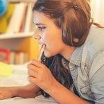 Teenager doing homework IN A TEENAGERS RETREAT